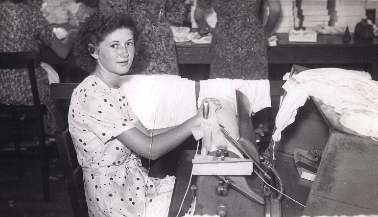 Heather Stacey (Scott) operating a Beatty Iron, c. 1950